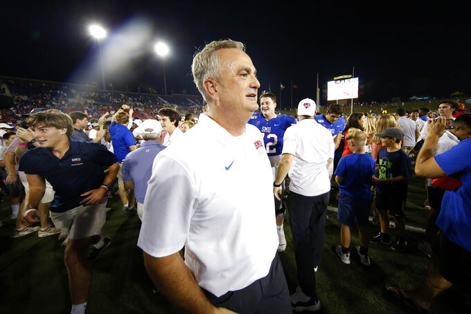 SMU coach Sonny Dykes walks off the field after the team's NCAA college football game against Tulsa, Saturday, Oct. 5, 2019, in Dallas. SMU won 43-37 in three overtimes. (AP Photo/Roger Steinman)