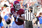 Oklahoma quarterback Spencer Rattler (7) carries for a touchdown in the first half of an NCAA college football game against Kansas in Norman, Okla., Saturday, Nov. 7, 2020. (AP Photo/Sue Ogrocki)