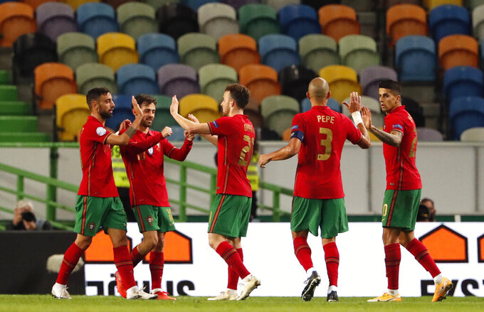 Portugal's Diogo Jota, centre, celebrates with teammates after scoring his side's third goal during the UEFA Nations League soccer match between Portugal and Sweden at the Jose Alvalade stadium in Lisbon, Portugal, Wednesday, Oct. 14, 2020. (AP Photo/Armando Franca)