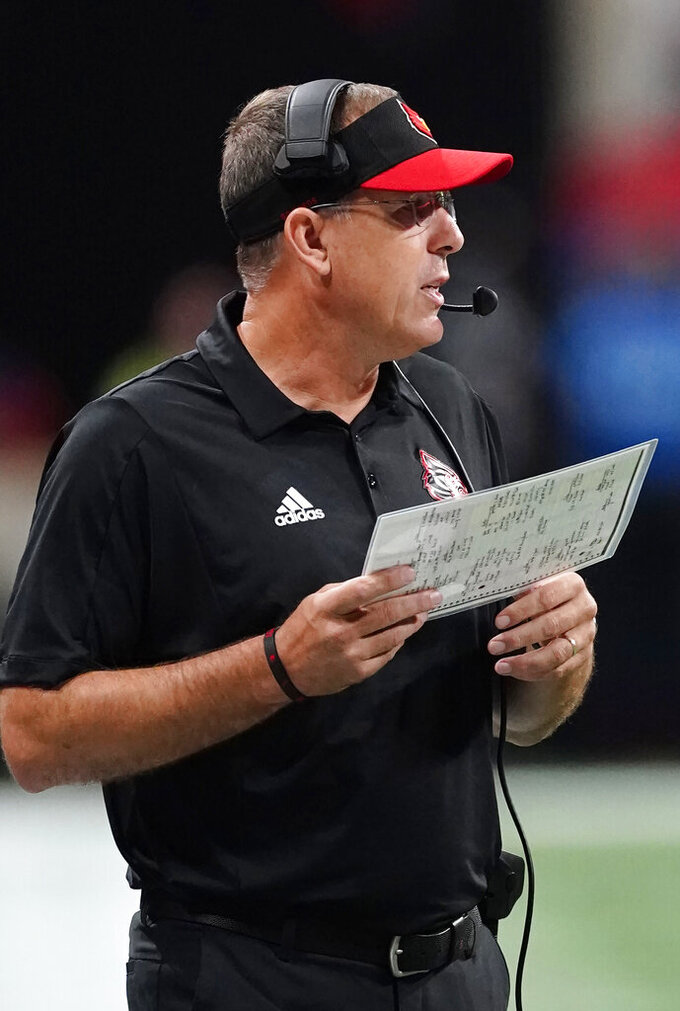 Louisville head coach Scott Statterfield watches from the sidelines during the first half of an NCAA college football game against Mississippi Monday, Sept. 6, 2021, in Atlanta. (AP Photo/John Bazemore)
