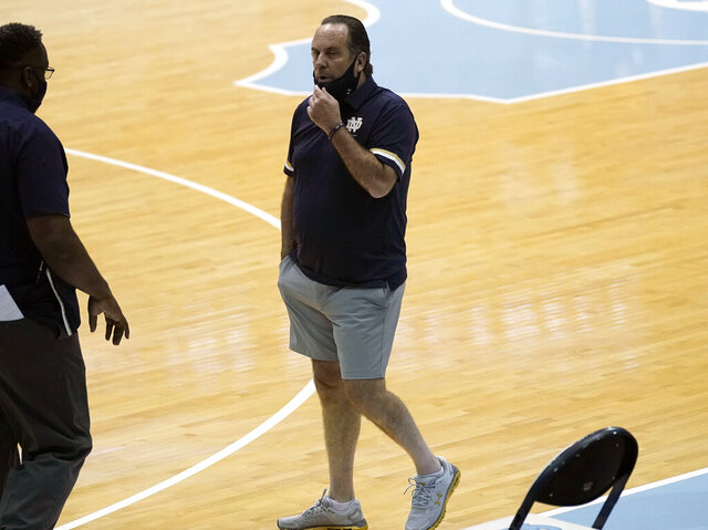 Notre Dame head coach Mike Brey looks on before an NCAA college basketball game against North Carolina in Chapel Hill, N.C., Saturday, Jan. 2, 2021. Brey said he took the notion of acceptable coaching attire to a