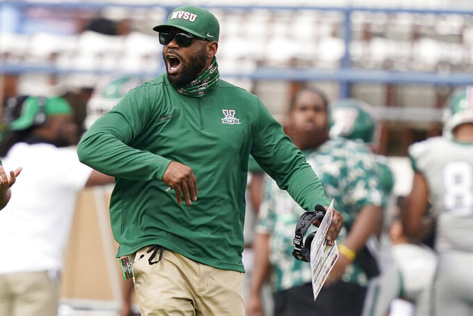 Mississippi Valley State football coach Vincent Dancy encourages his players during the first half of an NCAA college football game against Jackson State, Sunday, March 14, 2021, in Jackson, Miss. (AP Photo/Rogelio V. Solis)
