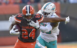Cleveland Browns running back Nick Chubb (24) rushes against Miami Dolphins outside linebacker Jerome Baker (55) during the first half of an NFL football game, Sunday, Nov. 24, 2019, in Cleveland. (AP Photo/David Richard)