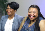 FILE - In this June 7, 2018 file photo, Alice Marie Johnson, left, and her daughter Katina Marie Scales wait to start a TV interview on in Memphis, Tenn. Johnson, an inmate whose life sentence was commuted thanks in part to the efforts of Kim Kardashian West, now has a book deal, along with a deal for film and television rights. Harper, an imprint of HarperCollins Publishers, announced Wednesday, Feb. 6, 2019, that Johnson's