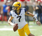 FILE - In this Sept. 29, 2018, file photo, West Virginia's Will Grier (7) looks to pass the ball during the second half of an NCAA college football game against Texas Tech, in Lubbock, Texas. No. 6 Oklahoma and No. 12 West Virginia meet in a regular season finale with the winner headed to the Big 12 championship game. The loser could also make it to the December 1 title game, but would need help. The Sooners and Mountaineers play Friday night, Nov. 23, 2018, after Texas plays at Kansas earlier in the day. The Longhorns clinch a spot in the Big 12 title game if they beat the Jayhawks. (AP Photo/Brad Tollefson, File)