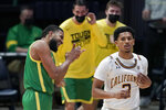 Oregon guard LJ Figueroa, left, celebrates after scoring as California guard Jarred Hyder, right, walks up court during the second half of an NCAA college basketball game in Berkeley, Calif., Saturday, Feb. 27, 2021. (AP Photo/Jeff Chiu)