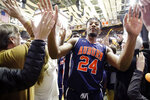 Auburn forward Anfernee McLemore celebrates with fans as he leaves the court after Auburn beat Vanderbilt 64-53 in an NCAA college basketball game Saturday, Feb. 16, 2019, in Nashville, Tenn. (AP Photo/Mark Humphrey)