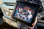 Gerry Jensen holds a photograph of her extended family as she poses for a portrait at her family's farm on Wednesday, Sept. 25, 2019, in Benjamin, Utah. Their son Eric currently lives on the property, another son, Ryan, lives next door, and Jensen stated that they and their siblings will eventually take over the family farm. (Isaac Hale/The Daily Herald via AP)