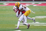Minnesota defensive back Jordan Howden (23) tackles Nebraska wide receiver Wan'Dale Robinson (1) during the second half of an NCAA college football game in Lincoln, Neb., Saturday, Dec. 12, 2020. Minnesota won 24-17. (AP Photo/Nati Harnik)