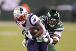 New York Jets strong safety Jamal Adams (33) tackles New England Patriots' James White (28) during the first half of an NFL football game Monday, Oct. 21, 2019, in East Rutherford, N.J. (AP Photo/Bill Kostroun)