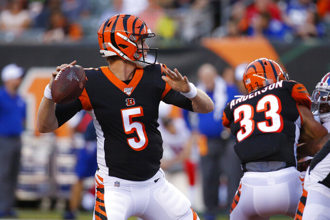 Cincinnati Bengals quarterback Ryan Finley looks for a receiver during the first half of the team's NFL preseason football game against the New York Giants, Thursday, Aug. 22, 2019, in Cincinnati. (AP Photo/Frank Victores)