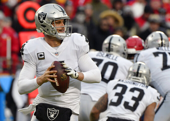 FILE - In this Dec. 30, 2018, file photo, Oakland Raiders quarterback Derek Carr (4) looks for a receiver during the first half of an NFL football game against the Kansas City Chiefs. in Kansas City, Mo. After an offseason filled with rumors about his job status, Carr is back again as starting quarterback for the Raiders. (AP Photo/Ed Zurga, File)
