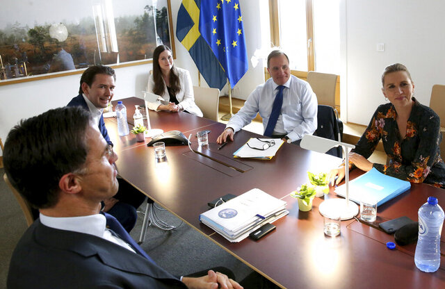 from left, Dutch Prime Minister Mark Rutte, Austria's Chancellor Sebastian Kurz, Finland's Prime Minister Sanna Marin, Sweden's Prime Minister Stefan Lofven and Denmark's Prime Minister Mette Frederiksen meet on the sidelines of an EU summit at the European Council building in Brussels, Sunday, July 19, 2020. Leaders from 27 European Union nations meet face-to-face for a third day of an EU summit to assess an overall budget and recovery package spread over seven years estimated at some 1.75 trillion to 1.85 trillion euros. (AP Photo/Francois Walschaerts, Pool Photo via AP)