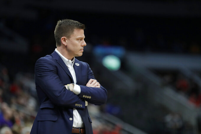 Valparaiso head coach Matt Lottich is seen on the sidelines during the first half of an NCAA college basketball game against Evansville in the first round of the Missouri Valley Conference men's tournament Thursday, March 5, 2020, in St. Louis. (AP Photo/Jeff Roberson)