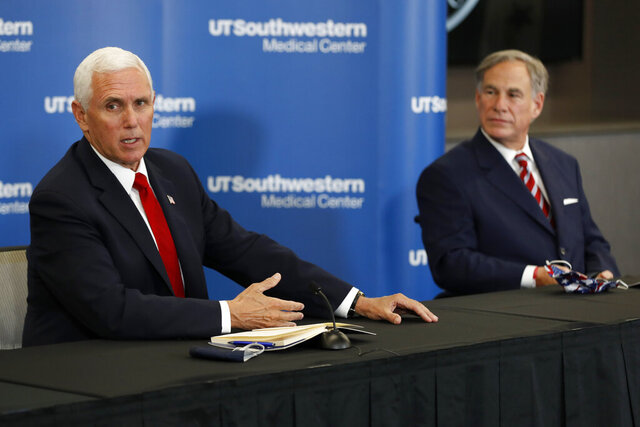 Vice President Mike Pence makes remarks as Texas Gov. Greg Abbott looks on during a news conference after Pence met with Abbott and members of his healthcare team regarding COVID-19 at the University of Texas Southwestern Medical Center West Campus in Dallas, Sunday, June 28, 2020. (AP Photo/Tony Gutierrez)