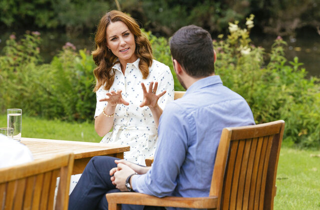 In this image taken in July 2020 and issued by Kensington Palace, Britain's Kate, the Duchess of Cambridge meets with a member of the four organisations that will benefit from the Royal Foundation COVID-19 response fund, on the Sandringham Estate, Sandringham, England. The Royal Foundation of the Duke and Duchess of Cambridge has granted nearly GBP 1.8 million in supporting the frontline community and the nation's mental health, through a bespoke fund which was set up as part of the organisation's response to COVID-19. (Kensington Palace via AP)