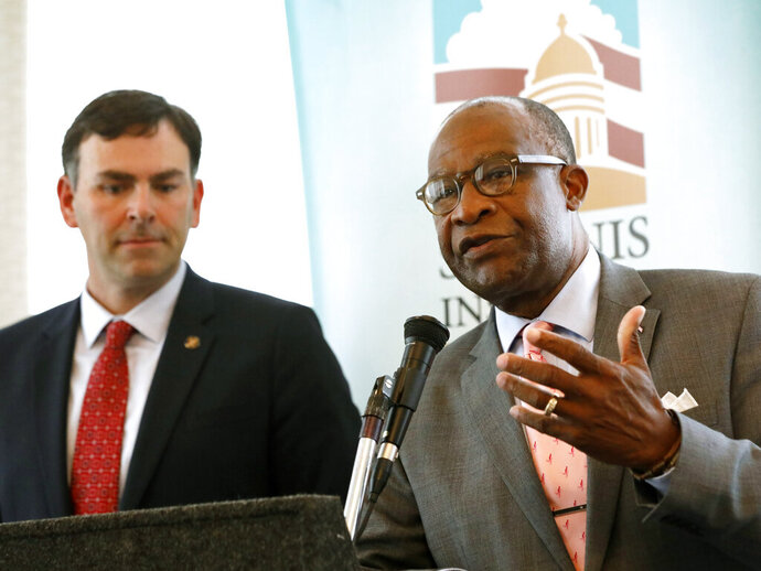 Republican Sen. Michael Watson of Pascagoula, left, listens as Democratic former Hattiesburg Mayor Johnny DuPree, responds to a question at a forum sponsored by Mississippi State University's Stennis Institute of Government and the Capitol Press Corps, Monday, Oct. 21, 2019, in Jackson, Miss. Both men are candidates for secretary of state. (AP Photo/Rogelio V. Solis)