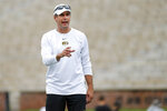 Missouri offensive coordinator Derek Dooley calls out instructions during an NCAA college football practice Monday, Aug. 12, 2019, in Columbia, Mo. (AP Photo/Jeff Roberson)