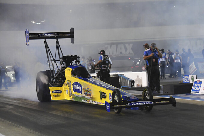 In this photo provided by the NHRA, Brittany Force takes part in Top Fuel qualifying Friday, May 14, 2021, at the NGK NTK NHRA Four-Wide Nationals drag races in Concord, N.C. (Richard H Shute/NHRA via AP)