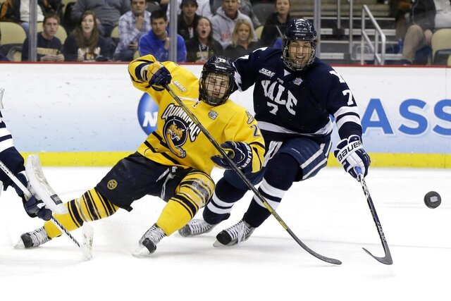 FILE - In this April 13, 2013, file photo, Quinnipiac's Matthew Peca, left, and Yale's Matt Killian go after a rebound during the first period of the NCAA Frozen Four men's college hockey national championship game in Pittsburgh. Yale, Quinnipiac, UConn and Sacred Heart will headline the first Connecticut Ice festival on Saturday, Jan. 25 and Sunday, Jan. 26, 2020, in Bridgeport. The schools have been talking for more than a decade about holding a tournament similar to Boston's Beanpot in an effort to raise the profile of college hockey in the state. (AP Photo/Gene Puskar, File)
