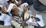 FILE - In this May 2, 2013 file photo, supporters of Pakistan's religious party pray for the slain al-Qaida leader Osama bin Laden at rally to pay tribute to him in Quetta, Pakistan. Pakistan's prime minister Imran Khan accused the United States on Thursday, June 25 2020, of having