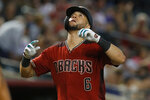 Arizona Diamondbacks left fielder David Peralta reacts after hitting a solo home run against the San Francisco Giants in the seventh inning during a baseball game, Sunday, Aug. 18, 2019, in Phoenix. (AP Photo/Rick Scuteri)