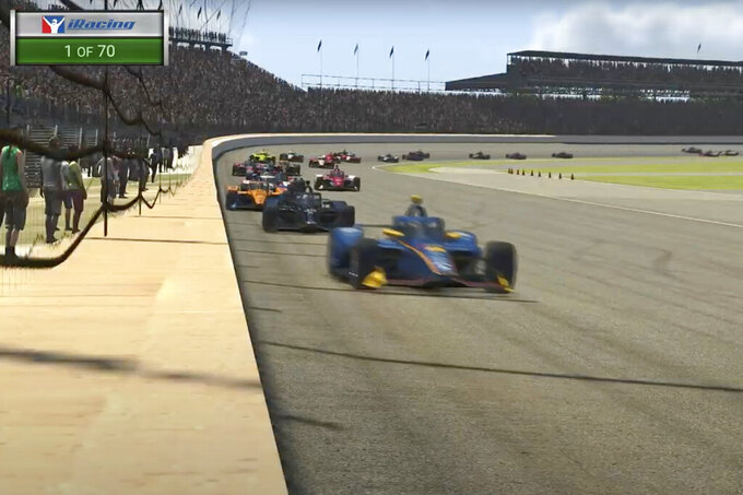 In this image taken from video provided by iRacing IndyCar, driver Scott McLaughlin, front, leads the field during the first lap of the First Responder 175 presented by GMR virtual IndyCar auto race at the Indianapolis Motor Speedway, Saturday, May 2, 2020, in Indianapolis, Ind. (iRacing IndyCar via AP)