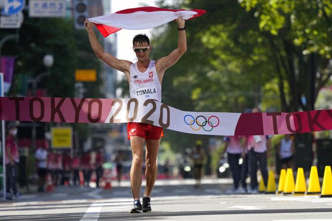 Dawid Tomala, of Poland, celebrates after placing first in the men's 50km race walk at the 2020 Summer Olympics, Friday, Aug. 6, 2021, in Sapporo, Japan. (AP Photo/Shuji Kajiyama)