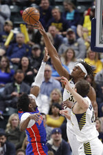 Indiana Pacers' Myles Turner (33) blocks the shot of Detroit Pistons' Langston Galloway (9) during the second half of an NBA basketball game, Monday, April 1, 2019, in Indianapolis. Indiana won 111-102. (AP Photo/Darron Cummings)