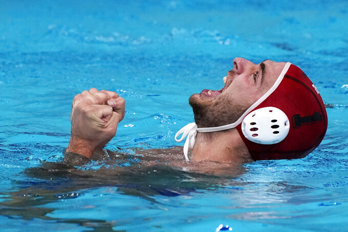 Greece goalkeeper Emmanouil Zerdevas celebrates after a win over Hungary in a semifinal round men's water polo match at the 2020 Summer Olympics, Friday, Aug. 6, 2021, in Tokyo, Japan. (AP Photo/Mark Humphrey)