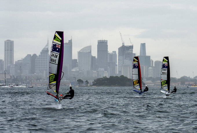This photo provided by SailGP shows Australia SailGP Team host women's selection camp, from left to right Lisa Darmanin, Nina Curtis and Natasha Bryant in Sydney, Australia on Feb. 6, 2021. Darmanin was one of three top Aussie women sailors who participated in an invitational camp recently in Sydney as part of a new program aimed at accelerating the inclusion of female athletes in SailGP, the global league co-founded by New Zealander Russell Coutts and tech titan Larry Ellison. (Beau Outteridge/SailGP via AP)