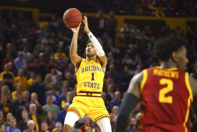 Arizona State guard Remy Martin hits the go-ahead basket as Southern California guard Jonah Mathews (2) looks away from Martin during the second half of an NCAA college basketball game Saturday, Feb. 8, 2020, in Tempe, Ariz. Arizona State won 66-64. (AP Photo/Ross D. Franklin)