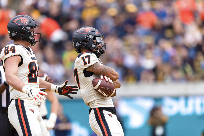 Oregon State wide receiver Isaiah Hodgins (17) reacts with tight end Teagan Quitoriano (84) after scoring a touchdown against the California  in the second quarter of an NCAA college football game in Berkeley, Calif., Saturday, October 19, 2019. (AP Photo/John Hefti)