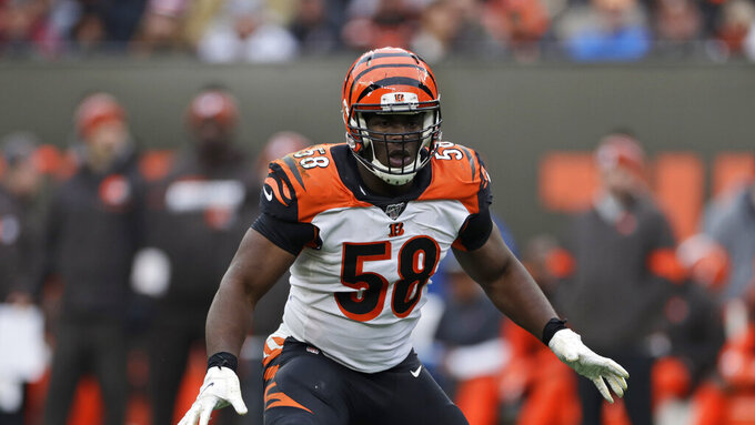 FILE - In this Sunday, Dec. 8, 2019, file photo, Cincinnati Bengals defensive end Carl Lawson (58) keeps watch during the second half of an NFL football game against the Cleveland Browns, in Cleveland. On Monday, March 15, 2021, the Jets agreed to terms on a three-year deal with former Cincinnati Bengals defensive end Carl Lawson, according to a person with direct knowledge of the move. (AP Photo/Ron Schwane, File)