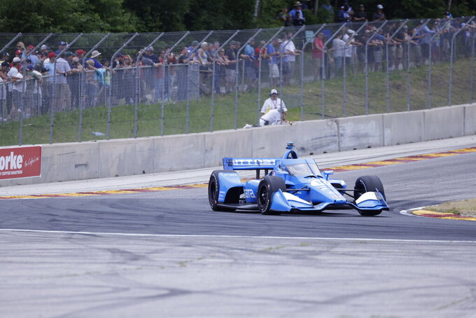Alex Palou competes during an IndyCar race at Road America in Elkhart Lake, Wisc., Sunday, June 20, 2021. (AP Photo/Jeffrey Phelps)