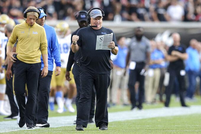 UCLA coach Chip Kelly calls a play during the first half of the team's NCAA college football game against Cincinnati on Thursday, Aug. 29, 2019, in Cincinnati. (Kareem Elgazzar/The Cincinnati Enquirer via AP)