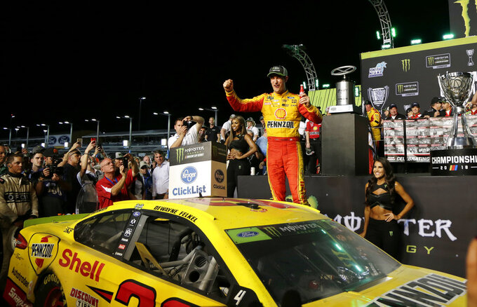 Joey Logano celebrates after winning the NASCAR Cup Series Championship auto race at the Homestead-Miami Speedway, Sunday, Nov. 18, 2018, in Homestead, Fla. (AP Photo/Terry Renna)