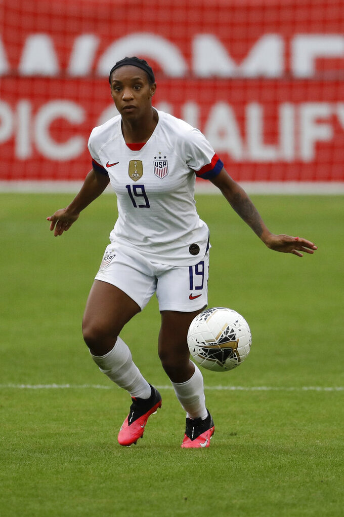 """FILE - U.S. defender Crystal Dunn plays against Canada during the second half of a CONCACAF women's Olympic qualifying soccer match in Carson, Calif., in this Sunday, Feb. 9, 2020, file photo. The 28-year-old U.S. national team defender has grown more confident in her abilities and her status on the U.S. women's national team. She's also become empowered in her activism as a Black woman. So much so that she even proclaimed herself the """"New Crystal Dunn."""" (AP Photo/Chris Carlson, File)"""