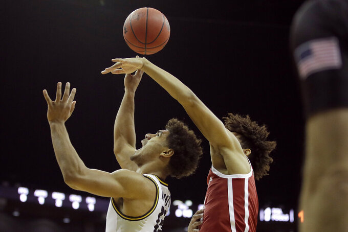 Oklahoma forward Jalen Hill, right, tries to block a shot by Missouri guard Mark Smith (13) during the first half of an NCAA college basketball game, Tuesday, Nov. 26, 2019, in Kansas City, Mo. (AP Photo/Charlie Riedel)