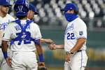 Kansas City Royals manager Mike Matheny, right, takes the ball from relief pitcher Jake Newberry during the seventh inning of a baseball game against the Chicago White Sox at Kauffman Stadium in Kansas City, Mo., Thursday, Sept. 3, 2020. (AP Photo/Orlin Wagner)