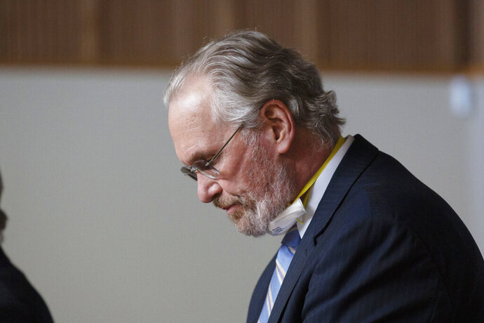 Bill Johnson, chief executive officer and president of PG&E Corp., lowers his head after admitting the company's guilt in the deaths of 84 people in a 2018 wildfire, during a hearing in Butte County Superior Court in Chico, Calif., Tuesday, June 16, 2020. Johnson entered guilty pleas on behalf of the company for 84 felony counts of involuntary manslaughter stemming from the fire which was blamed on the company's crumbling electrical grid the wiped out the town of Paradise in November of 2018.(AP Photo/Rich Pedroncelli, Pool)