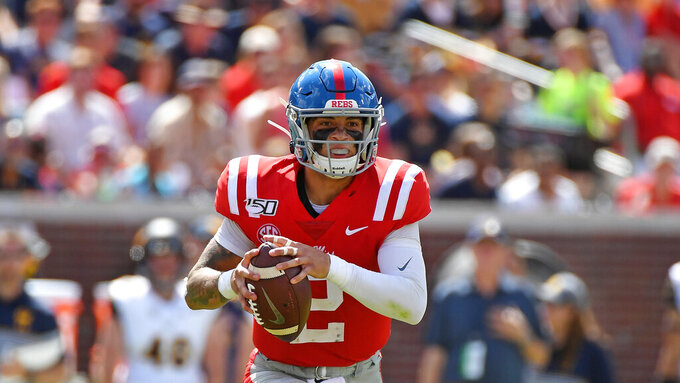 Mississippi quarterback Matt Corral (2) looks to pass during the first half of an NCAA college football game against California in Oxford, Miss., Saturday, Sept. 21, 2019. (AP Photo/Thomas Graning)