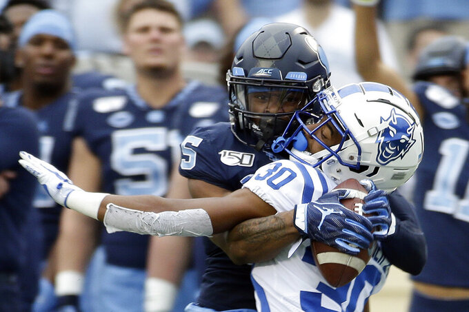 North Carolina wide receiver Dazz Newsome (5) catches a pass while Duke safety Jalen Alexander (30) defends during the first half of an NCAA college football game in Chapel Hill, N.C., Saturday, Oct. 26, 2019. (AP Photo/Gerry Broome)