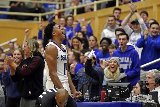 Seton Hall guard Jared Rhoden reacts after winning a loose ball against Stony Brook during the second half of an NCAA college basketball game, Saturday, Nov. 9, 2019, in South Orange, N.J. Seton Hall won 74-57. (AP Photo/Adam Hunger)