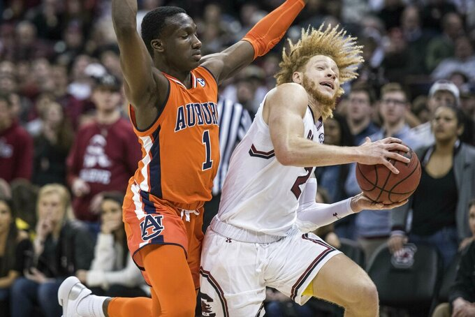 South Carolina guard Hassani Gravett (2) drives to the hoop against Auburn guard Jared Harper (1) during the second half of an NCAA college basketball game Tuesday, Jan. 22, 2019, in Columbia, S.C. South Carolina defeated Auburn 80-77. (AP Photo/Sean Rayford)