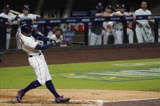 Houston Astros George Springer hits a two run home run against the Tampa Bay Rays during the fifth inning in Game 4 of a baseball American League Championship Series, Wednesday, Oct. 14, 2020, in San Diego. (AP Photo/Ashley Landis)