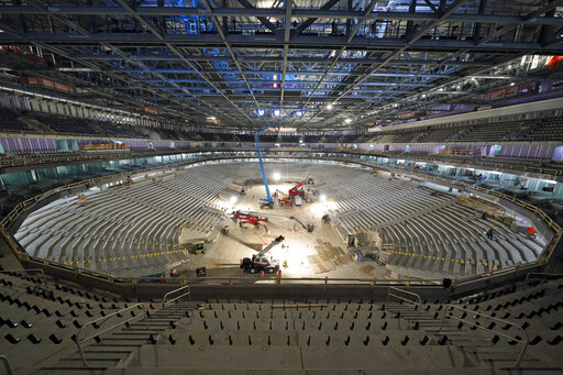 FILE- In this June 3, 2021, file photo, construction continues at the UBS Arena, the future home of the New York Islanders NHL hockey team, in Elmont, N.Y. As the Islanders prepare for the anticipated opening of their new home next month, they will begin with 13 straight road games — the longest such stretch in NHL history to start a season — while construction is completed. (AP Photo/Seth Wenig, File)