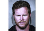 """FILE - This undated booking photo provided by the Maricopa County Sheriff's Office shows County Assessor Paul Petersen. Ronald Rasband, a leader in The Church of Jesus Christ of Latter-day Saints, told The Arizona Republic the church leadership has found the human smuggling charges against Maricopa County Assessor Paul Petersen """"sickening."""" (Maricopa County Sheriff's Office via AP, File)"""