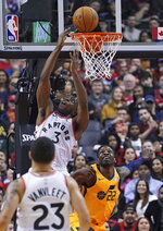 Toronto Raptors OG Anunoby (3) goes to the basket as Utah Jazz's Jeff Green (22) defends during first half NBA basketball action in Toronto, Sunday, Dec. 1, 2019. (Hans Deryk/The Canadian Press via AP)