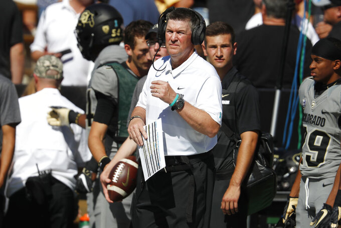 Colorado head coach Mike MacIntyre looks on in the first half of an NCAA college football game against New Hampshire, Saturday, Sept. 15, 2018, in Boulder, Colo. (AP Photo/David Zalubowski)